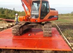 Строительство временной дороги на деревянных сваях, экологически чистая технология.